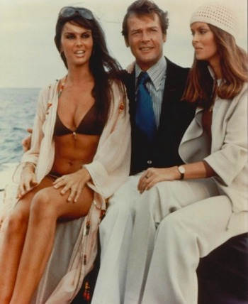 Caroline Munro, Roger Moore, and Barbara Bach relax between takes.