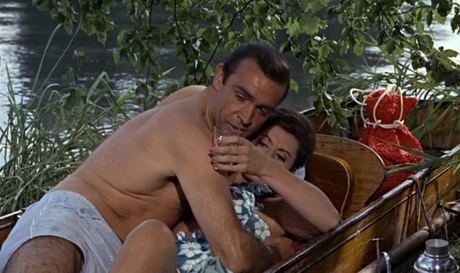 Bond's swim trunks go to waste as his call from work ensures that the champagne is the only thing getting wet in this scene. Unless...