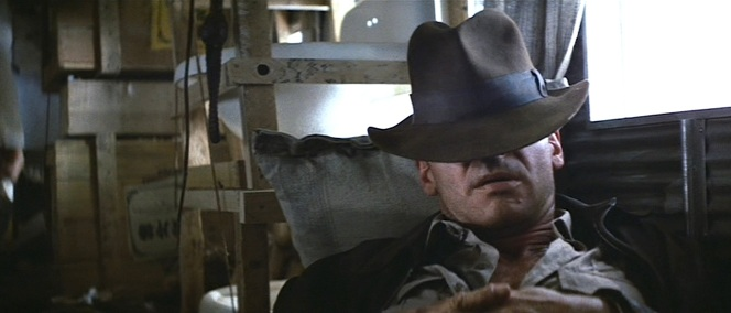 Indy's hat proves its usefulness when taking a snooze in Indiana Jones and the Temple of Doom.