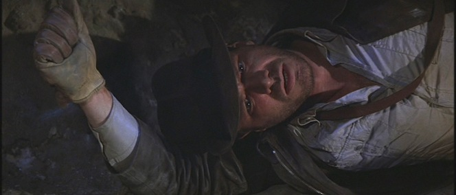 One of many tough spots in which Indy finds himself in Raiders of the Lost Ark.