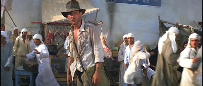 In Raiders of the Lost Ark, a weary Indy eyes his latest threat, a sword-wielding assassin...