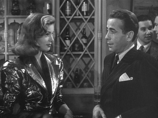 Clearly, Vivian was no longer mourning during the 1946 re-shoots when her black veil was replaced by a bold lamé jacket.