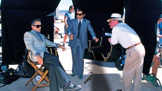 De Niro, Pesci, and Scorese between takes in the desert.