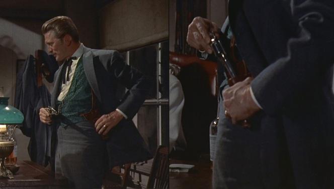 Wyatt Earp (Burt Lancaster) eyes Doc's shoulder rig.