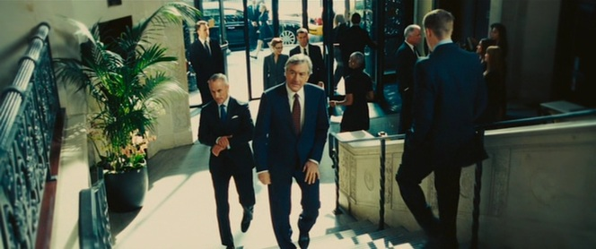 Van Loon's first appearance as he makes his way into the restaurant for his lunch meeting with Eddie.