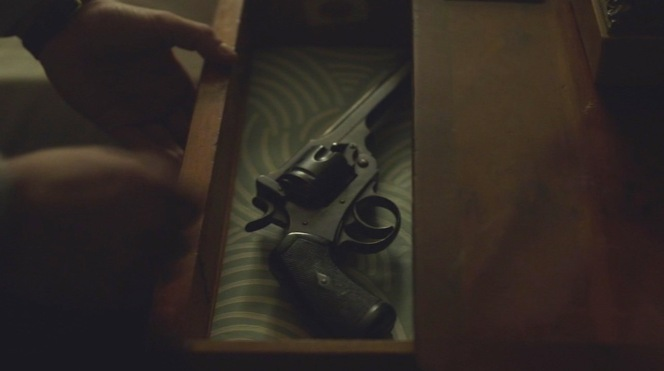 Lombard stashes his Webley away in a bedside drawer.