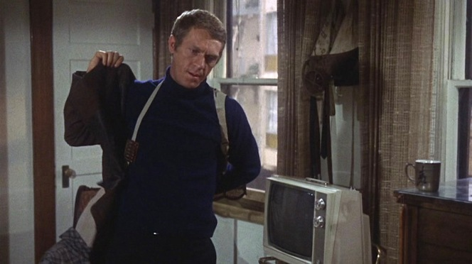 Bullitt's jacket is the last item he puts on once he is securely armed.