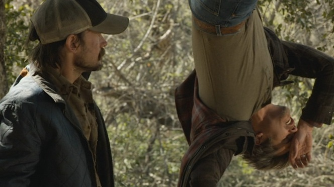 "Raylan's belt is best seen as he falls victim to Dickie Bennett's backwoods torture device in ""Bloody Harlan"" (Episode 2.13)."