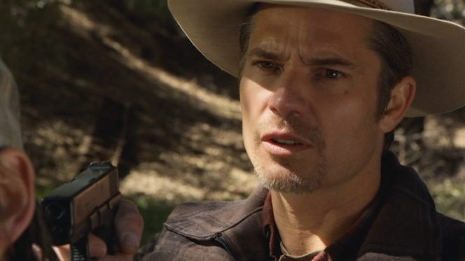 "Raylan draws his Glock to administer justice in ""Bloody Harlan"" (Episode 2.13)."