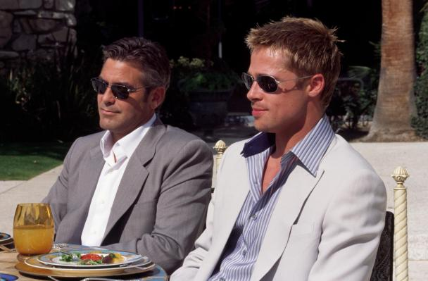 The subtle grid pattern of Danny's suit is best seen in this production photo of Clooney and Pitt on set.