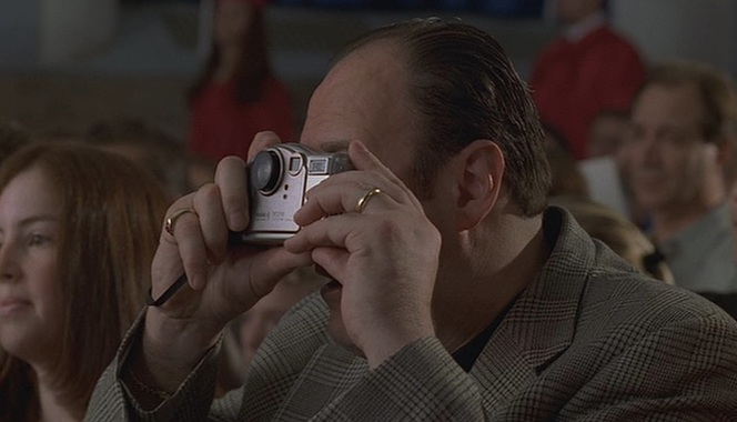 "Tony takes advantage of a picture-perfect moment during his daughter's high school graduation in ""Funhouse"" (Episode 2.13)."