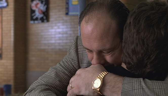"Tony embraces Christopher during Meadow's graduation in ""Funhouse"" (Episode 2.13)."