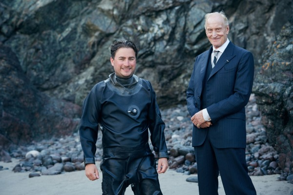 "As Henry Hill warned us in Goodfellas: ""Your murderers come with smiles."" This production photo shows Charles Dance in costume with a wet-suited crew member."