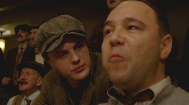 Sporting his flat cap, Jimmy corners an easily amused Al Capone in the first episode.