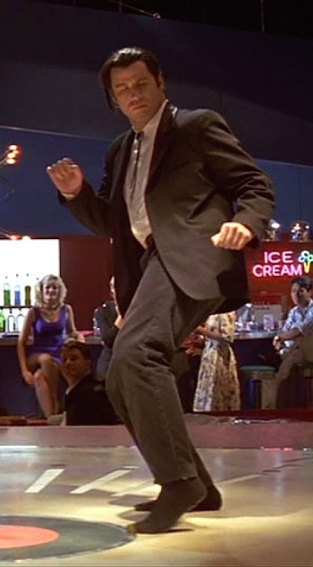 John Travolta as Vincent Vega in Pulp Fiction (1994).