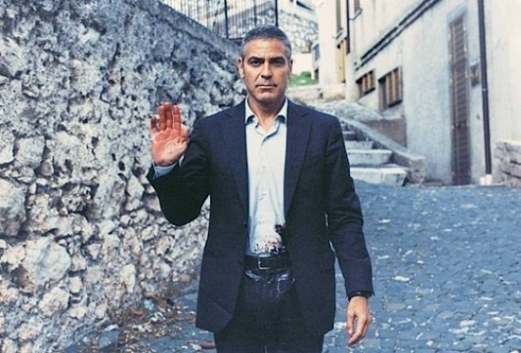 "A ""bloodied"" George Clooney cheekily poses on location while filming The American."