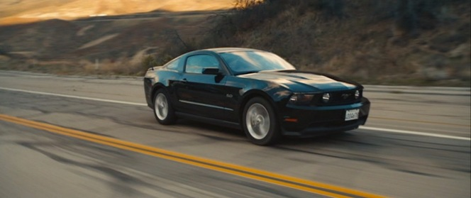 The Driver's Mustang speeds across the California desert.