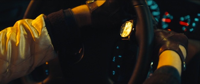 The Driver establishes his precision as he works his wristwatch in the opening scene.