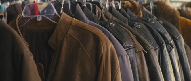 Reacher's brown leather jacket on a rack of several great Goodwill finds.