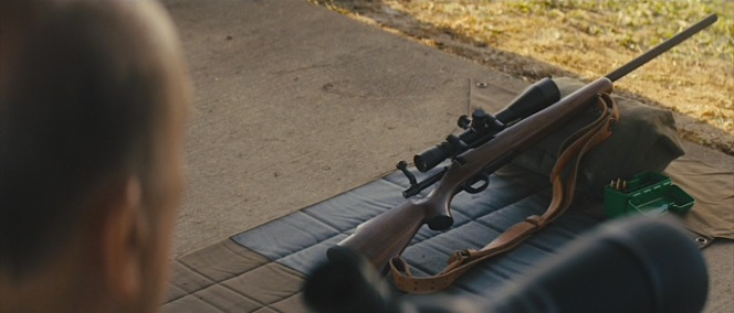 Cash's pride and joy, a Remington Model 700 rifle.