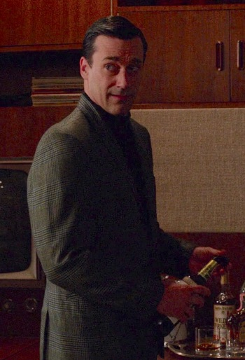 """Dehydrated after an afternoon of salty popcorn, Don Draper (Jon Hamm) turns to his trusty old Canadian Club upon returning home in """"The Quality of Mercy"""" (Mad Men, Episode 6.12)."""