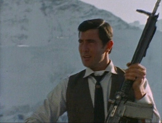 A documentary filmed during the production shows Lazenby, in shirt sleeves with a loosened tie, fooling around with a SIG SG 510 battle rifle prop.