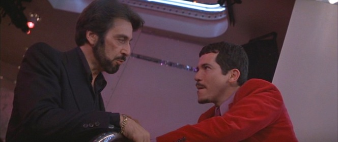 "Carlito's all-black attire in this scene further draws the line of contrast between ""old school"" Carlito and the brash, flashy, and irresponsible Benny Bianco in his bright red three-piece suit."