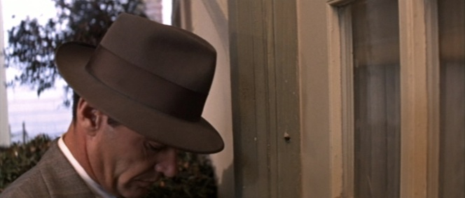 This shot also gives us another good look at Gittes' striped suiting.