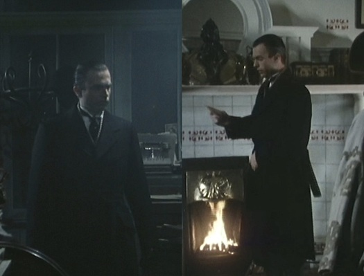 Reilly keeps extra warm by donning a heavy wool overcoat and standing next to a fire.
