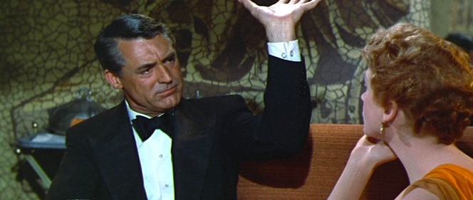 The chain-style links are two-sided, visible on both sides of his wrist as Cary Grant here appears to be mansplaining either elevator mechanics or appropriate serving methods to Deborah Kerr.