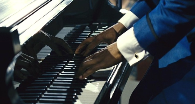 Ray pounds the keys of his black Baldwin piano during a 1962 gig in St. Louis.