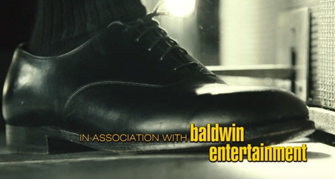 "Ray's footwear also gets some attention during the opening credits. You couldn't ask for a better shot of his oxfords... except maybe without the ""Baldwin Entertainment"" credit getting in the way."