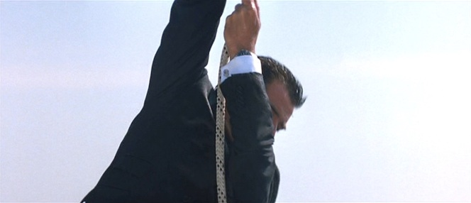 Dangling over the Thames is no place for expensive cufflinks... let alone a made-to-measure Italian suit!