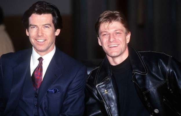 Brosnan and Bean smiling for reporters in January 1995.