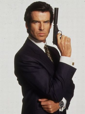 Pierce Brosnan wears the Brioni suit with the Sulka shirt and tie in a promotional photo, armed with Bond's trademark Walther PPK and silencer. Though he wears flat gold cuff links here, he would wear a dark gunmetal pair on screen.