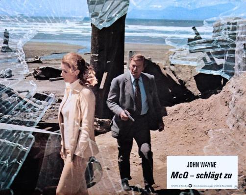 "McQ's footwear is best seen in the promotional shot featured in this German lobby card. Any German-speaking BAMFs out there able to translate ""schlägt zu"" in this context?"