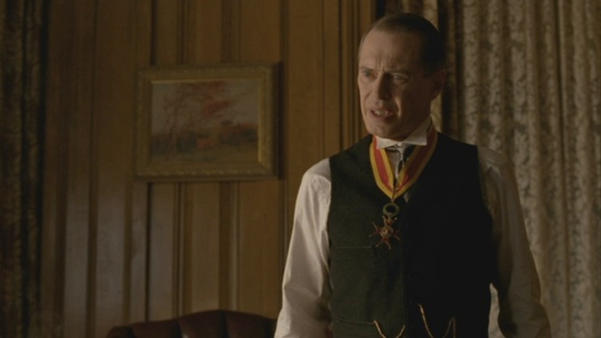 Nucky holds court at his Ritz suite after the ceremony.