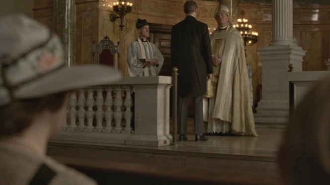 Nucky steps up to the altar to receive his Order of Knighthood.