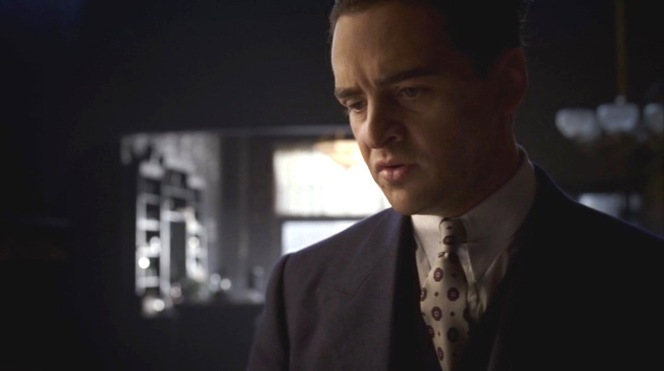 Lucky may not have physically pulled a trigger to end Masseria's life, but his tie's burgundy splashes against the pale ground of his shirt and tie evoke the image of Masseria's blood spatter... the very blood that Luciano needed to spill to ascend to his ultimate position of power in one of the few outright violent sequences of his fifth season appearances.