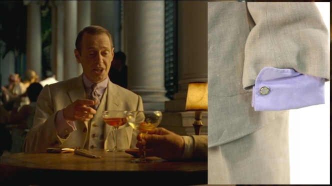 Nucky flashes his cuffs while reaching for his cocktail. The suit's auction page provided a nice view of the shirt cuff and links featured on screen.