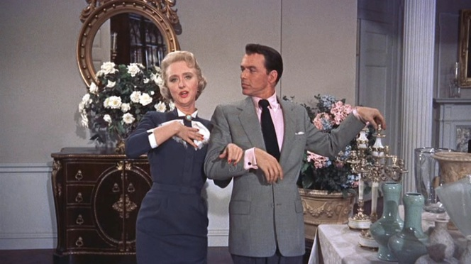 Liz Imbrie (Celeste Holm) leads Mike in song.