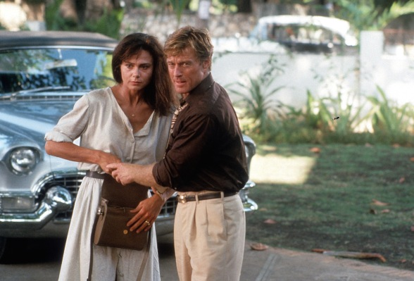 Production photo of Lena Olin and Robert Redford in Havana with Jack's snazzy silver Caddy convertible behind them.
