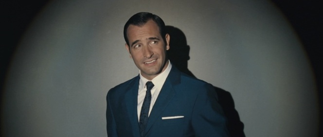 OSS 117 hams it up in a suit beautifully tailored for the occasion.