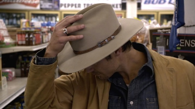 """Honestly? I tried it on one time, and it fit,"" is Raylan's explanation for his iconic hat when questioned later by Rachel in ""Riverbrook"" (episode 1.02)."