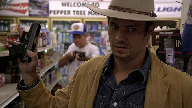 Raylan is forced to hand over his backup Glock 26.