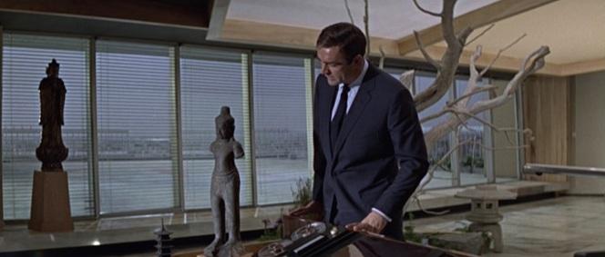 Bond checks out Osato's distinctive office decor.
