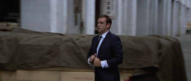 Straightening his tie, adjusting his cuffs... Bond always finds time for a wardrobe adjustment after a major action sequence.