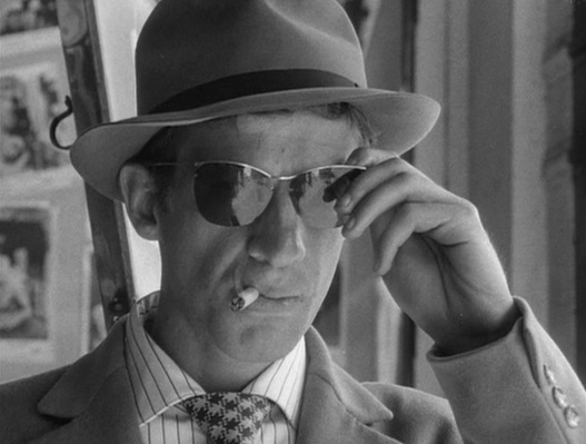 Michel is the type of guy who reverently takes off his sunglasses in honor of a photo of Humphrey Bogart but leaves them on when kissing his girlfriend.