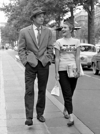 Jean-Paul Belmondo as Michel Poiccard and Jean Seberg as Patricia Franchini strolling down the Champs-Élysées in an iconic scene from À bout de souffle (Breathless) (1960).