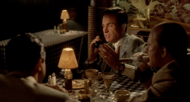 Dinner with the guys. Bugsy annoys George Raft (Joe Mantegna) and Mickey Cohen (Harvey Keitel) by not shutting up about his girlfriend the whole time.